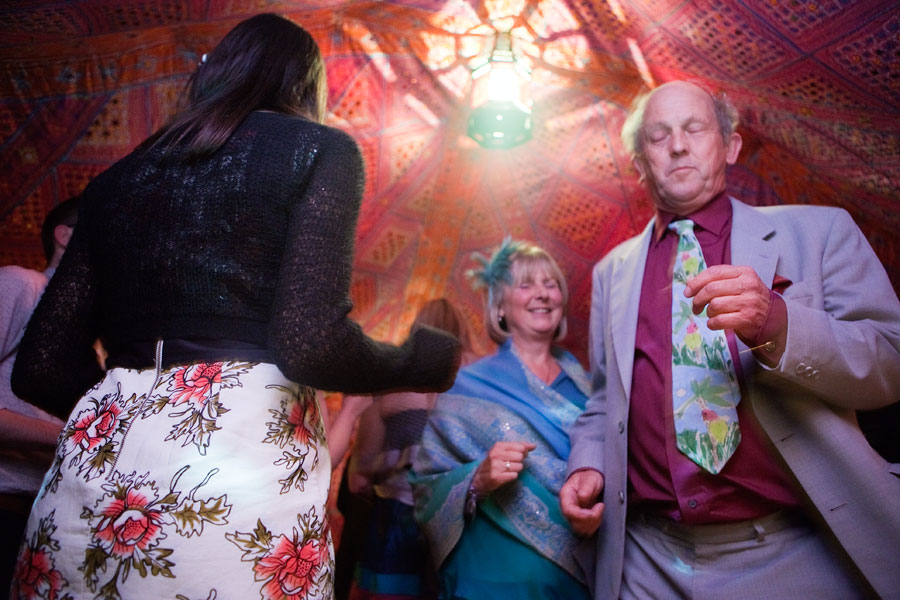 People dancing with their eyes closed at a brighton wedding reception