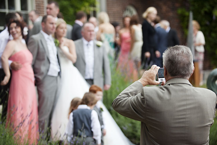photo of a wedding guest photographing other wedding guests