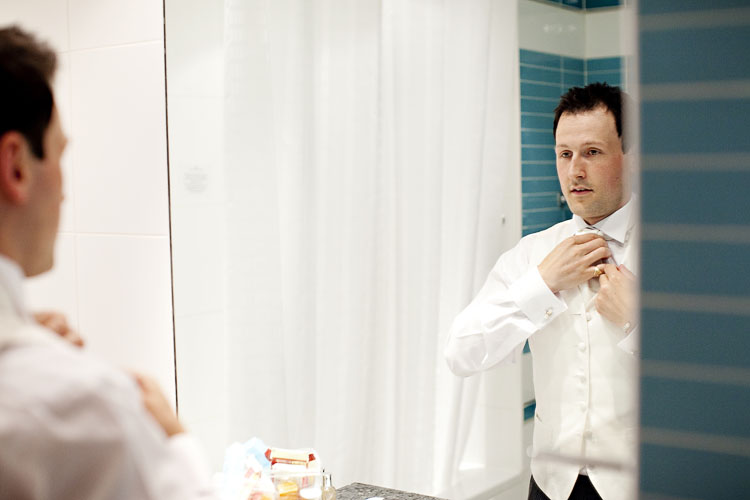 groom getting ready for wedding photography