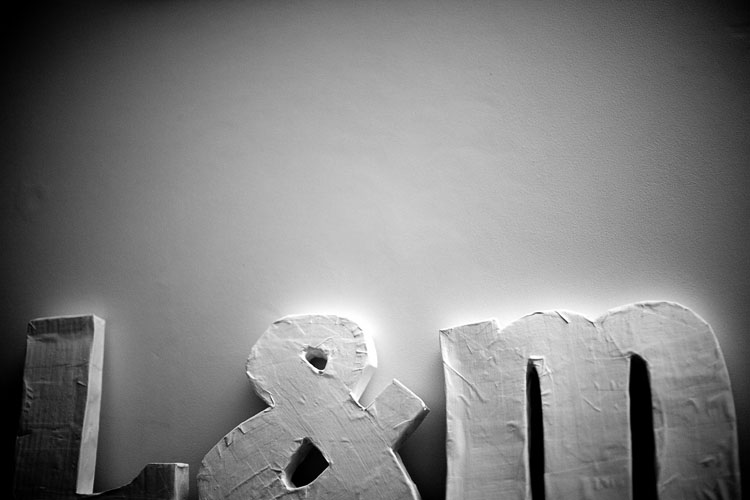 a photograph of the cardboard homemade letters against the white wall of our brighton loungeroom